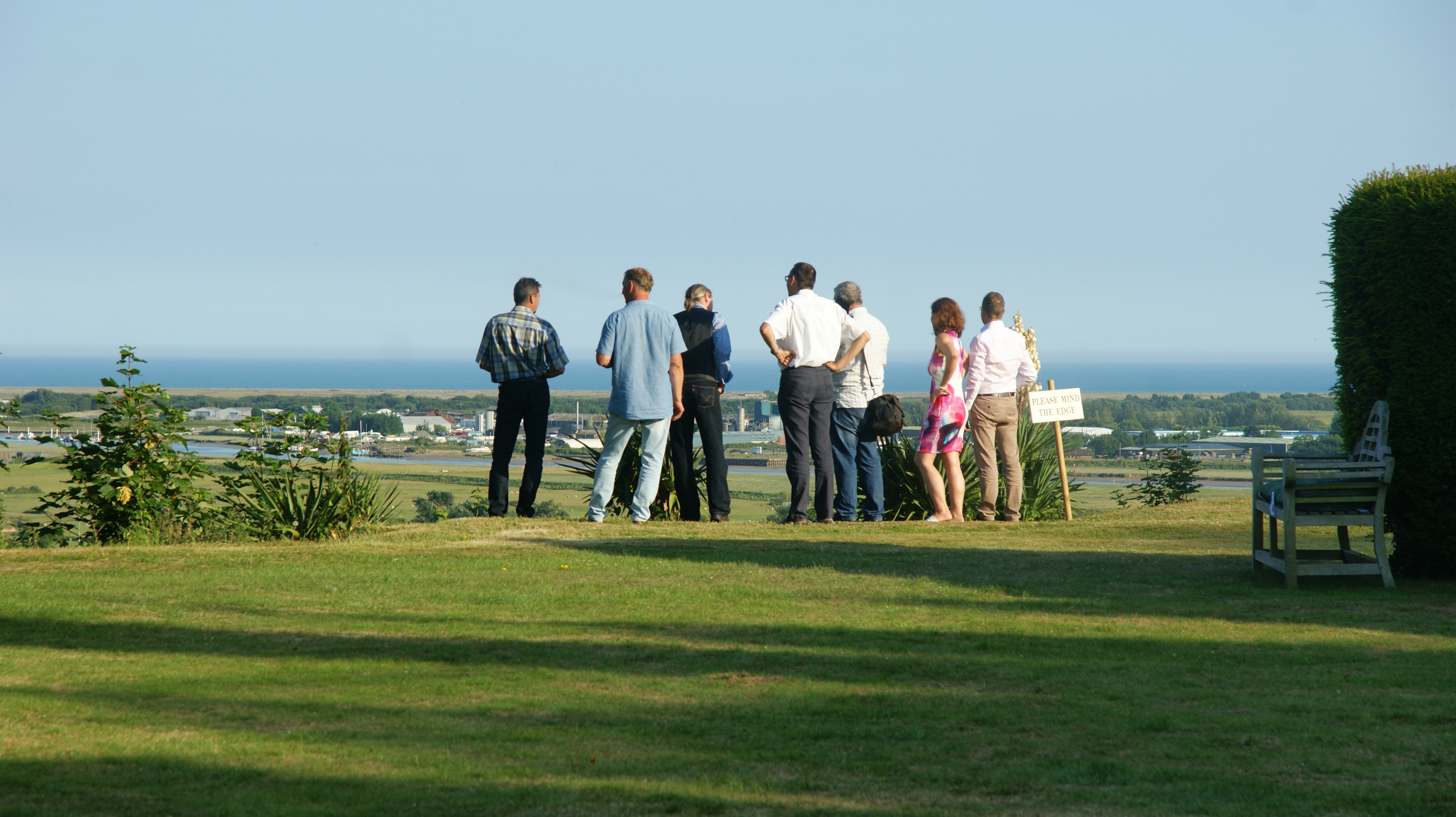 Family gathered at edge of garden appreciation the extensive views